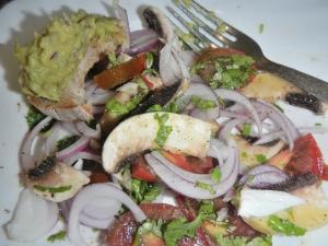 guacamole on toast with tomato salad